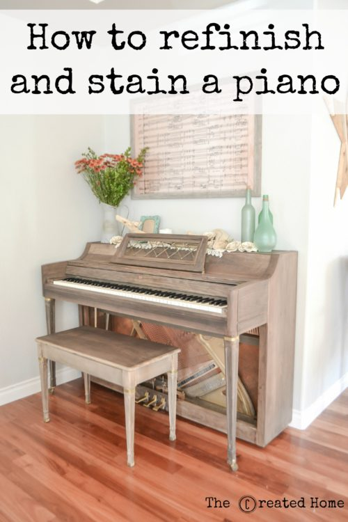 The framed piece of music over the piano is from Beethoven's 9th Symphony, which is my favorite piece of music. I created it by enlarging it onto a piece of engineering paper printed at Staples. The roses on top of the piano I folded out of sheets of music from vintage church hymnals.