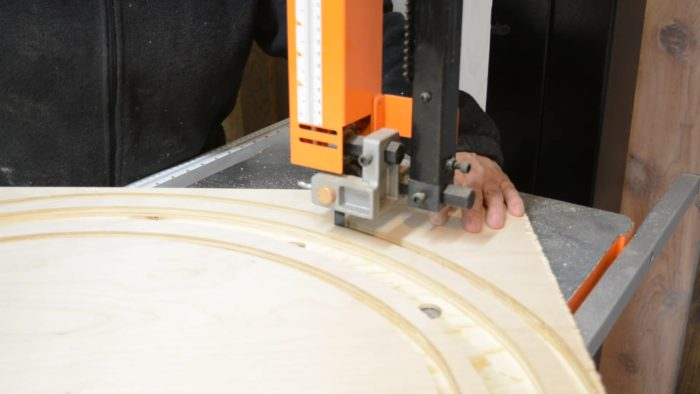 cutting outer edges of chandelier with the bandsaw